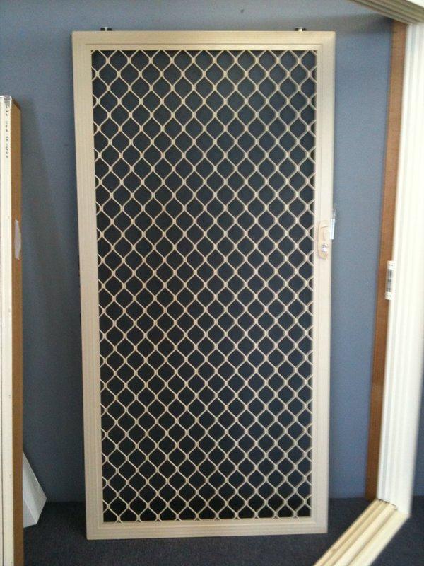 Barrier door diamond grille paw proof mesh stock for Mesh for windows and doors